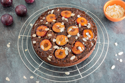 Sticky Chocolate Plum Cake on Cooling Rack