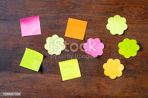 Sticky colorful notes in flower and square shapes isolated copy sticky colorful notes in flower and square shapes isolated copy space on wooden background stock photo more pictures of adhesive note istock mightylinksfo