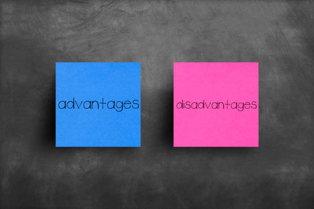 Sticky note on blackboard, Advantages disadvantages stock photo