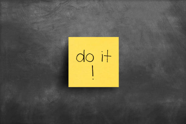 Sticky note on blackboard, Do it Sticky note on blackboard, Do it taking the plunge stock pictures, royalty-free photos & images