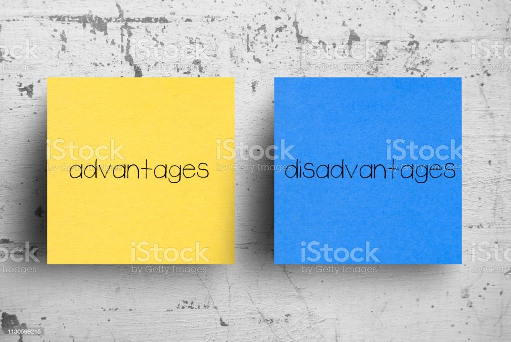 Sticky note on concrete wall, Advantages Disadvantages stock photo