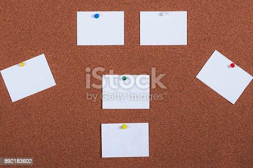 990092558 istock photo Sticky note on cork board 892183602