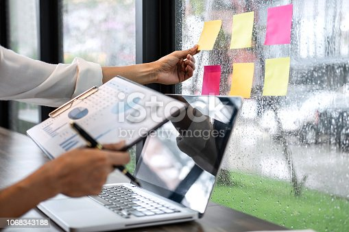 Sticky note paper reminder schedule board, Business woman accountant working audit and calculating expense financial annual report balance sheet statement, doing finance making notes.