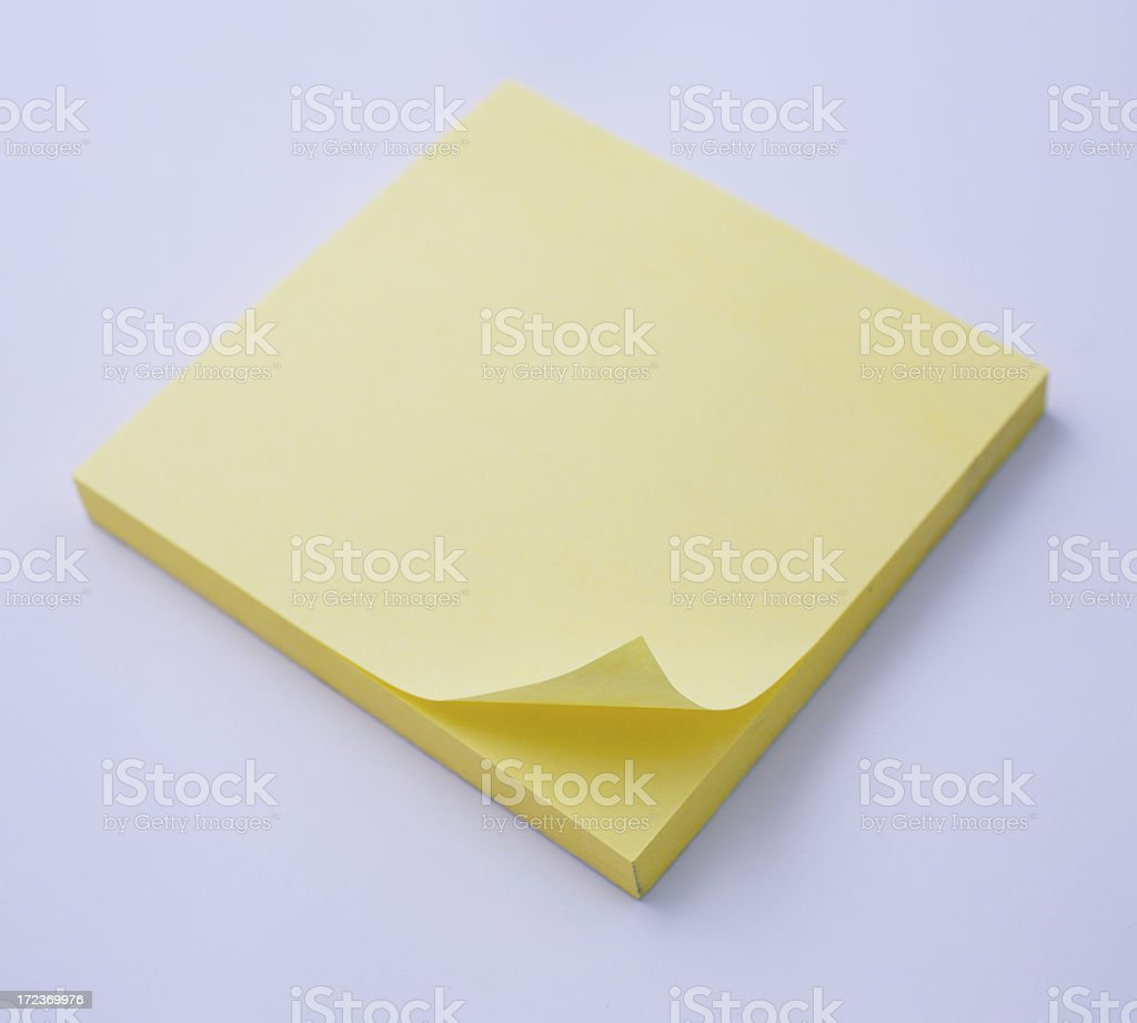 Sticky note (focus on curled edge) royalty-free stock photo