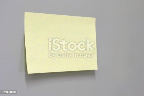 Sticky note on grey background.