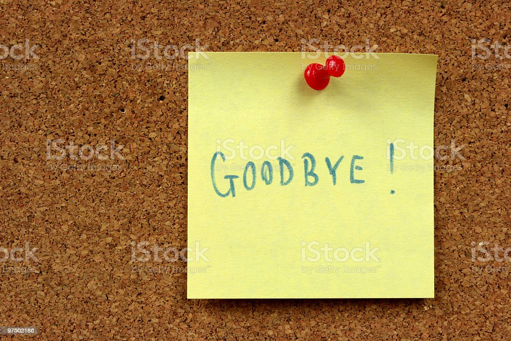 Sticky note reading Goodbye pinned to cork board royalty-free stock photo
