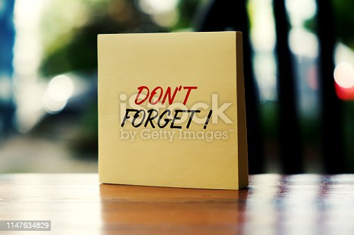 Sticky Note With Don't Forget Message