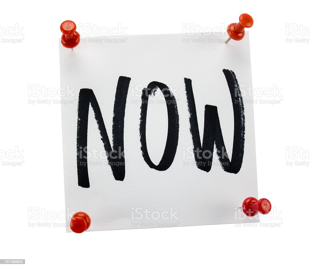Sticky note with the word NOW on white background royalty-free stock photo
