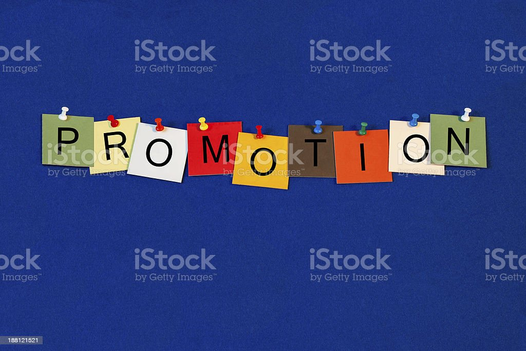 Sticky notes on blue wall spell 'Promotion' stock photo