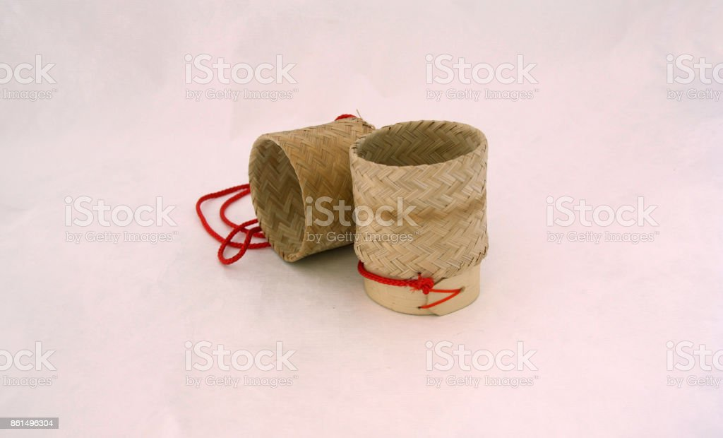 Sticky rice basket open the container with red hanging string on white background. stock photo