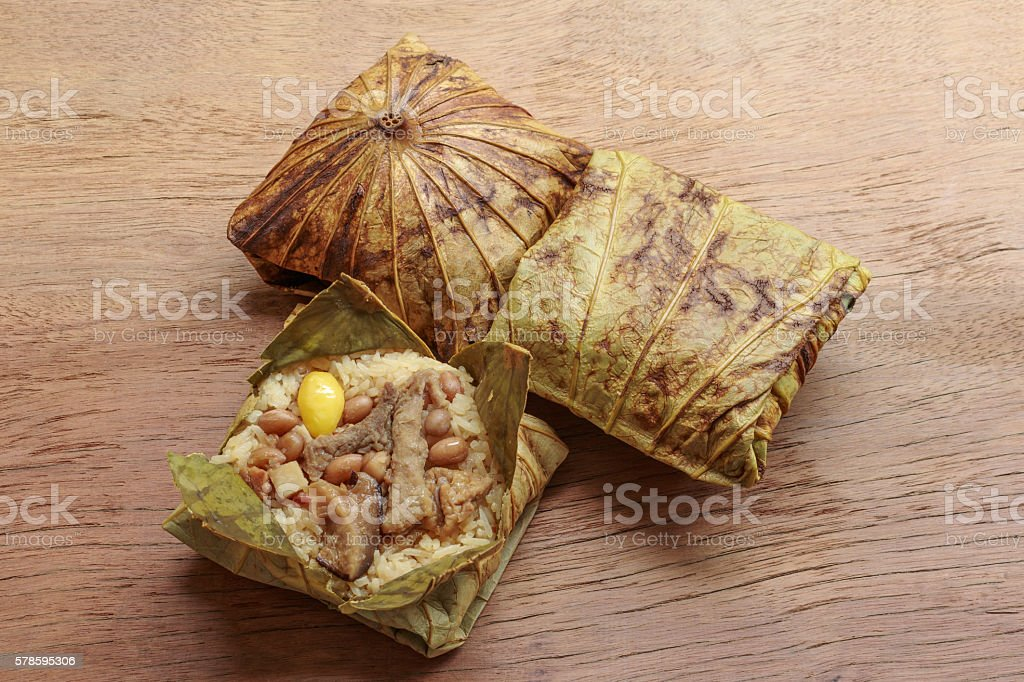 Sticky rice wrapped in lotus leaf or Zongzi stock photo