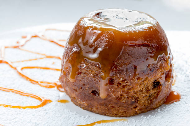 Sticky Toffee Pudding Close Up With Caramel Sauce stock photo