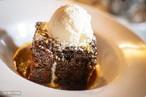 Sticky toffee pudding is a British dessert consisting of a very moist sponge cake, made with finely chopped dates, covered in a toffee sauce and often served with a vanilla custard or vanilla ice-cream