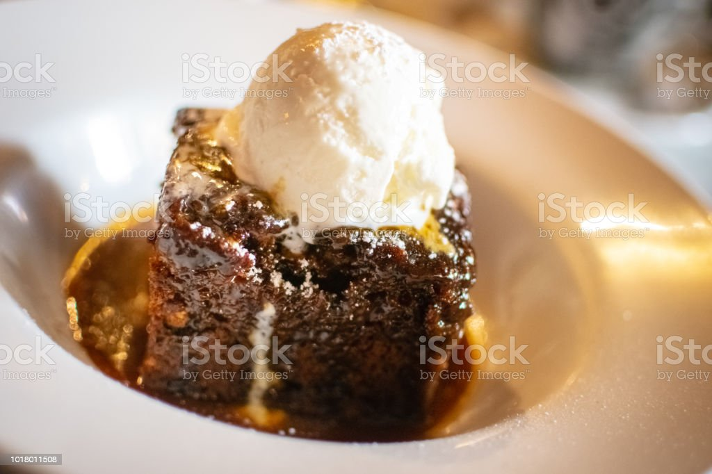 Sticky toffee pudding served with ice-cream stock photo