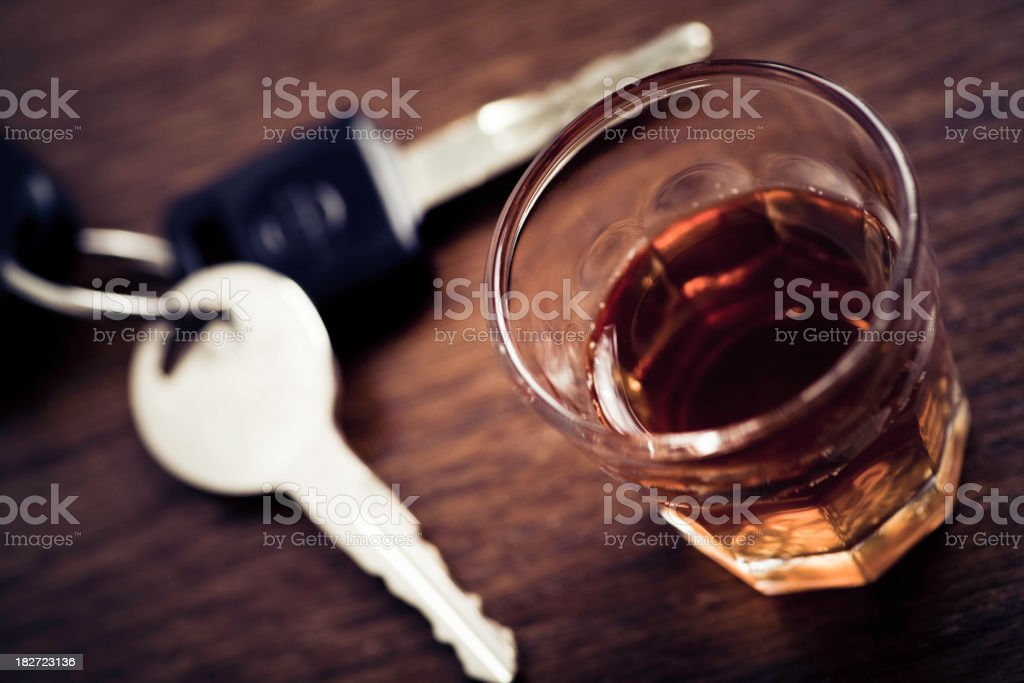 A stiff drink with confiscated keys to avoid drunk driving stock photo