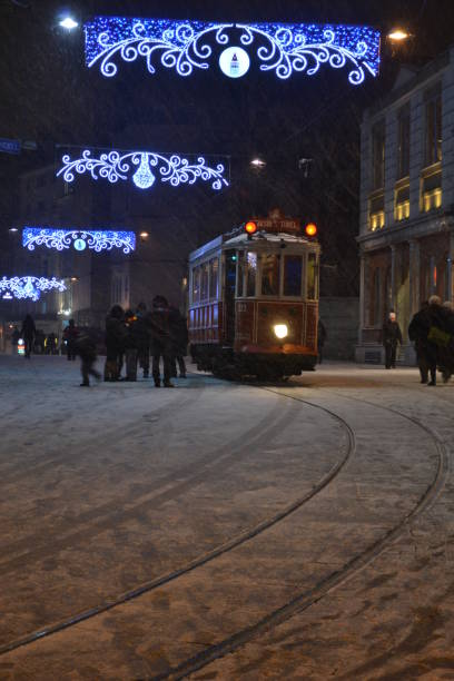 İstiklal Avenue Historical Tram at Snowfall in Winter İstanbul, Turkey stock photo