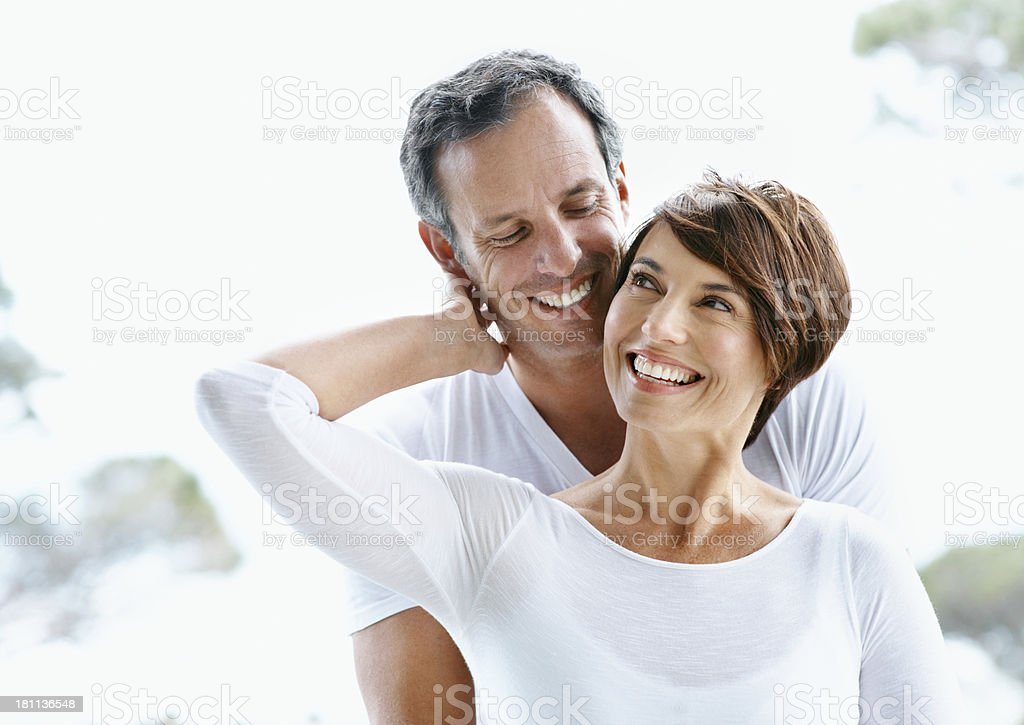 Still feeling the love A mature couple in matching clothes embracing each other in a park 40-49 Years Stock Photo