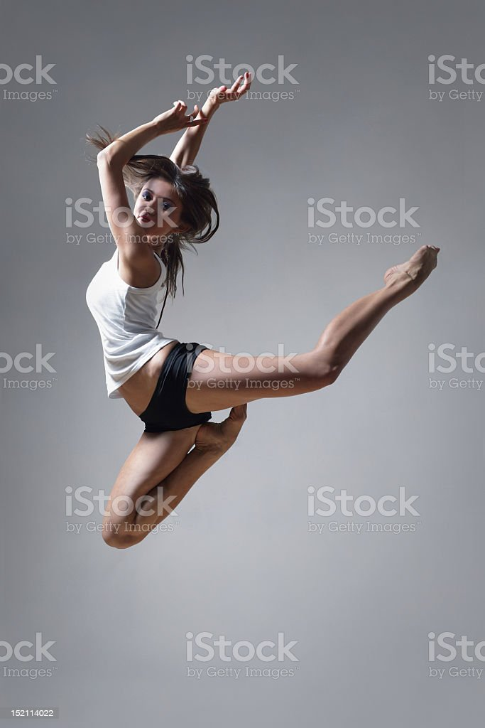Still image of a female dancer on mid air stock photo