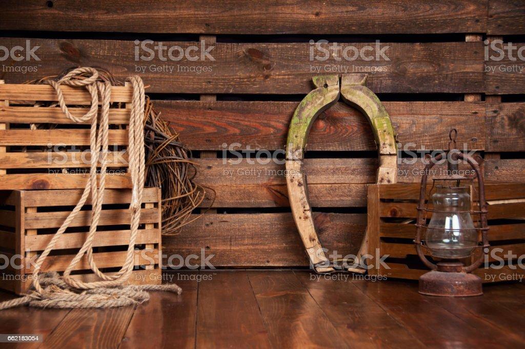 Still in cowboy style on wooden boards стоковое фото