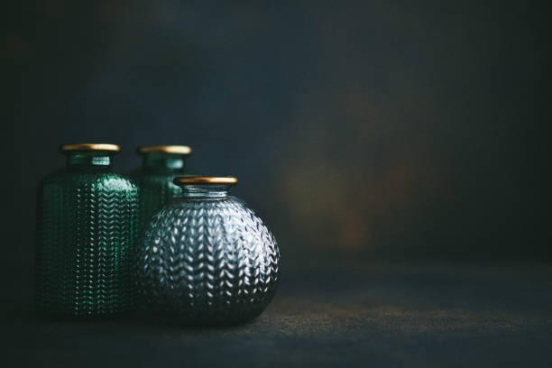 Still life background with small glass jars stock photo