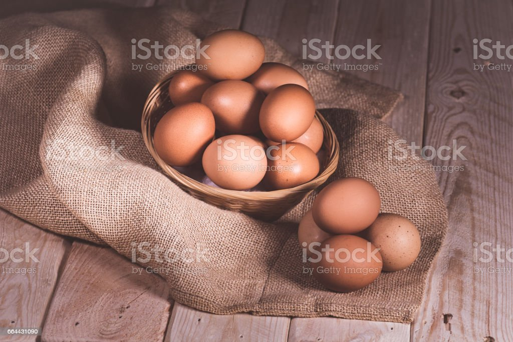 still life basket of eggs stock photo