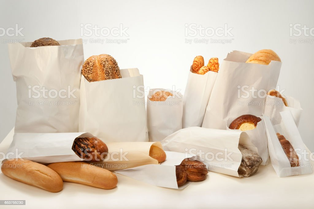 Still life. Bread with different additives with seeds, sesame seeds, cheese, cottage cheese, poppy seeds packed in paper bags. – Foto