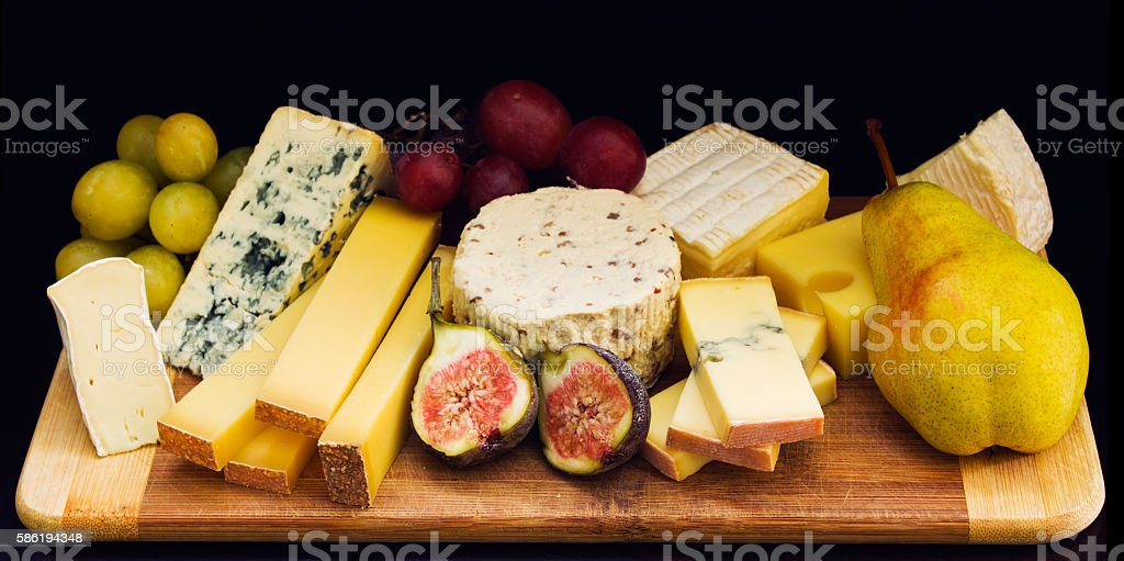 Still life composition with cheese stock photo