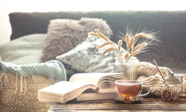 still life details of home interior on a wooden table with a cup of tea - hygge imagens e fotografias de stock