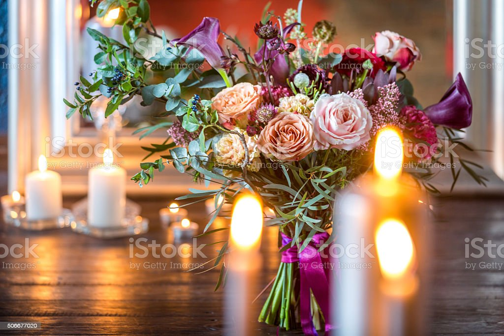 Still life. Flower arrangement and candles stock photo