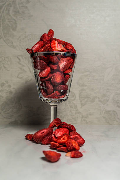 still life - freeze-dried strawberries in glass stock photo