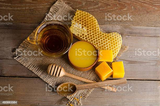 Still life from cup of tea, honey, wax and  honeycombs on wooden table. studio photo top view