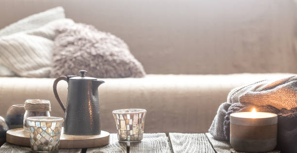still life from home interior on a wooden background with a candle - hygge imagens e fotografias de stock
