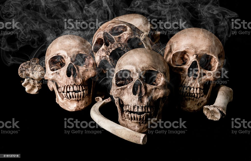 Still life human skull and bones on smoky, genocides concept stock photo