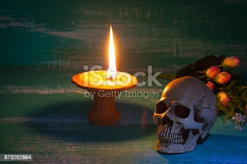 istock still life human skull on wood background with antique 873252664