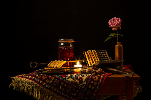 A classic still life in the Dutch style on a black blackground