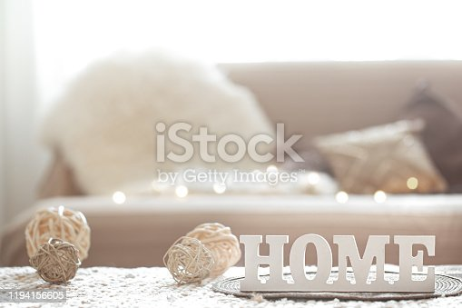 Still life in the living room with a wooden inscription home . The concept of home and comfort.
