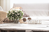 still life in the living room with wooden inscription home, the concept of home comfort
