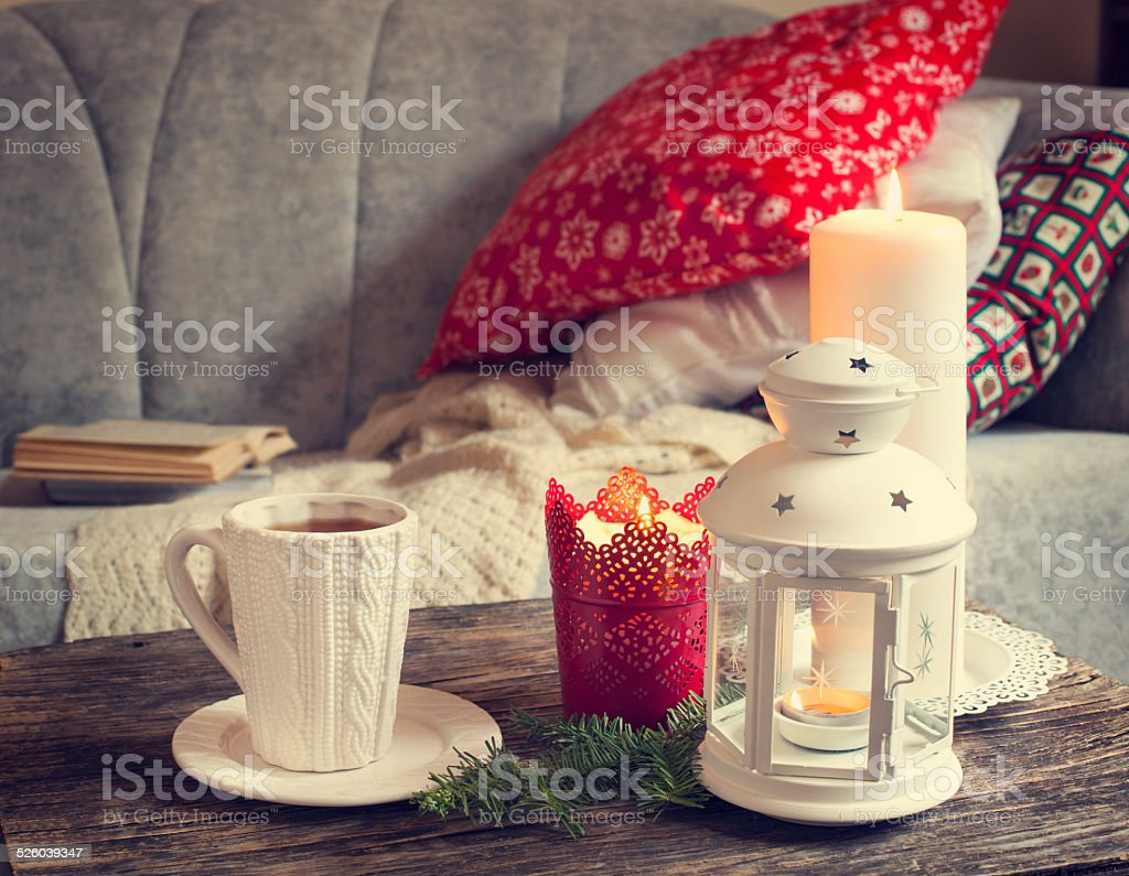 Still life interior details, cup of tea and candles stock photo