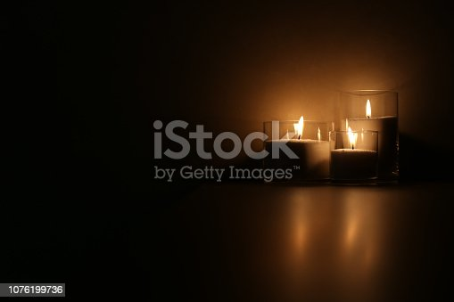 Three Burning Candles in the Dark. Copy Space. Background