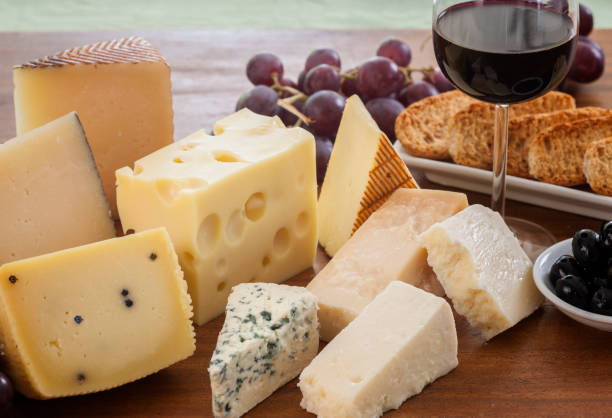 still life of cheeses and wine - formaggio foto e immagini stock