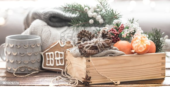 859424970istockphoto still life of Christmas decorations, a beautiful bowl of fruit and festive spice 901329774