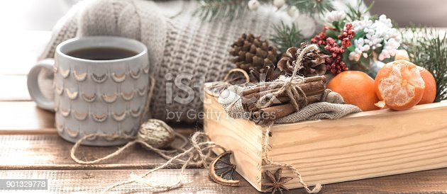 859424970istockphoto still life of Christmas decorations, a beautiful bowl of fruit and festive spice 901329778
