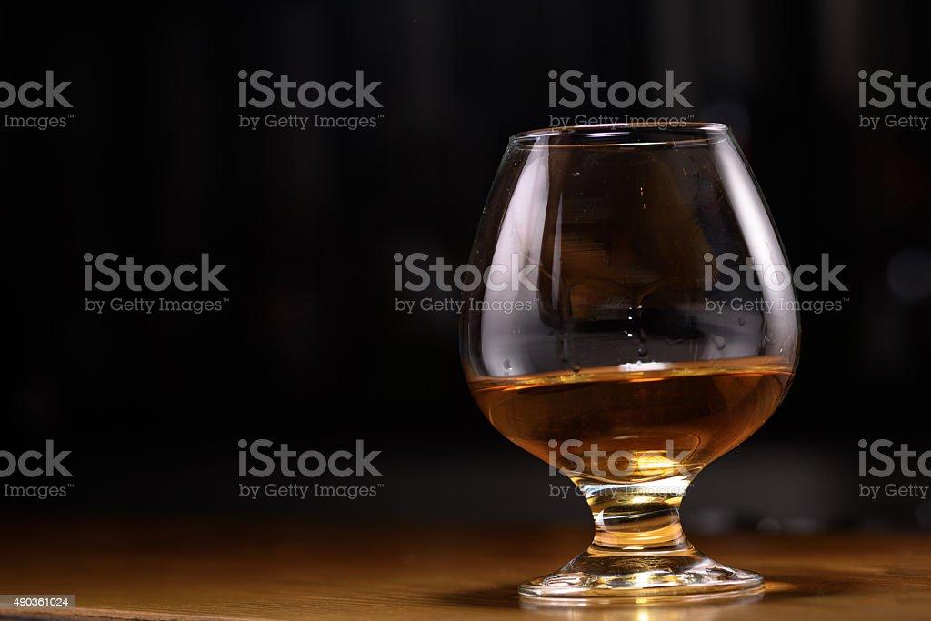 Still life of cognac glass on the bar stock photo