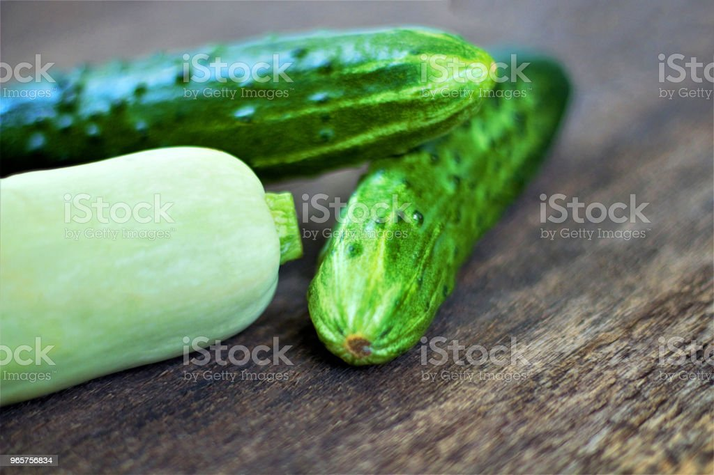 Still life of fresh vegetables. Zucchini (Cucurbita pepo subsp. Pepo) and cucumber (Cucumis sativus). Add to your diet. Healthy food. - Royalty-free Agriculture Stock Photo