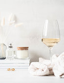 istock Still life of glass of white wine, sweater and various items 1288097968