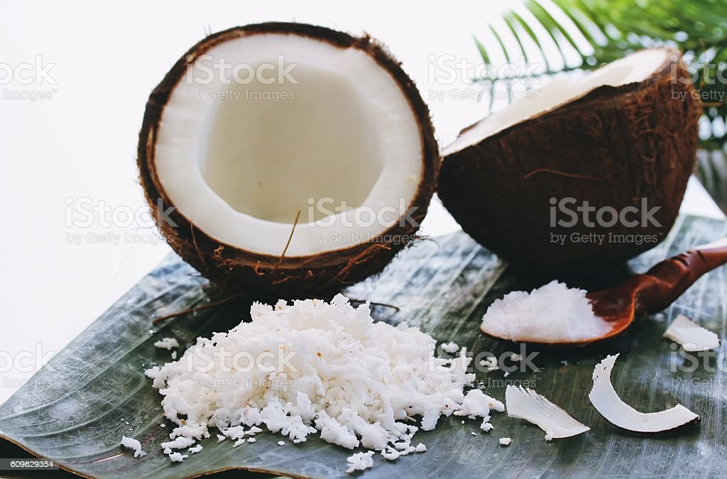 Still life of Grated fresh coconuts coconut oil and coconuts stock photo