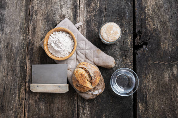 Still life of home made bread and ingredients stock photo