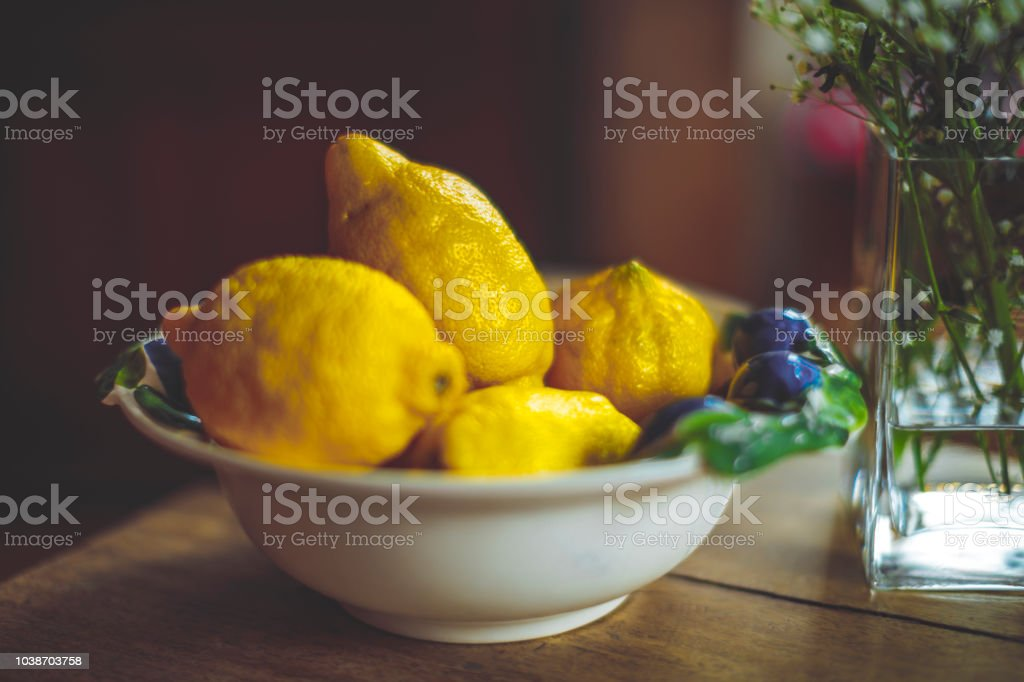 Still life of lemons on a bowl stock photo
