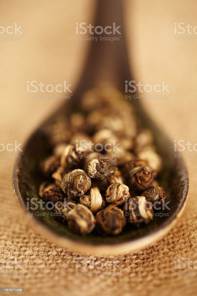 Still Life of organic green tea in wood spoon royalty-free stock photo