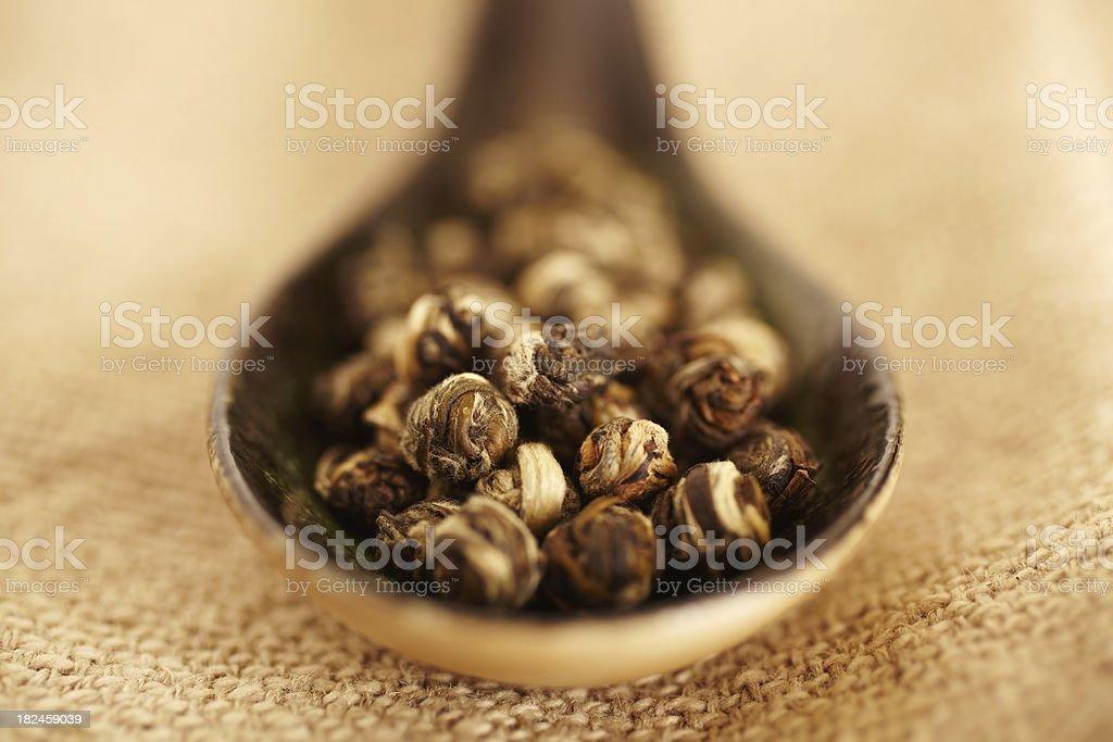 Still Life of organic green tea in wood spoon royalty-free stock photo
